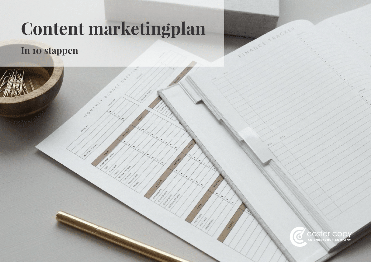 Content marketing kalender met pen en paperclips